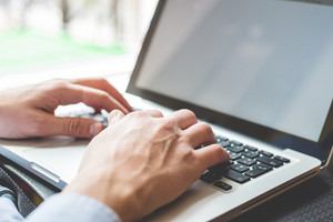 close up hands multitasking man using  laptop  connecting wifi