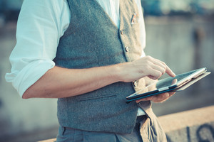 close up hipster man hands using tablet in the city