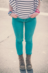 close up legs of young beautiful brunette woman in the city