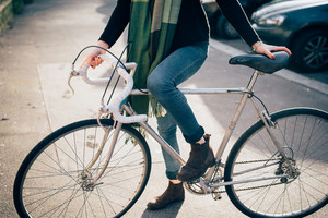 close up legs of young beautiful hipster sporty blonde woman in town with bike