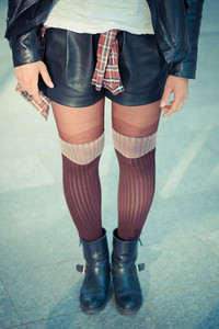 close up legs young beautiful woman in the city