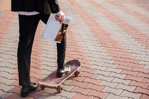 Close up man in suit on skate. cropped image