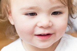 Close-up of  a happy smiling toddler girl
