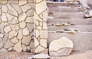 Close up of an unfinished  stairs and stone wall