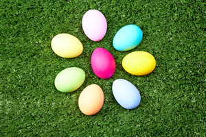 Close-up of colorful Easter eggs on green grass