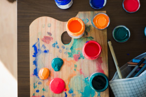 close up of colorful painter palette at home