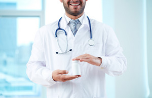 Close-up of doctor holding new medicine