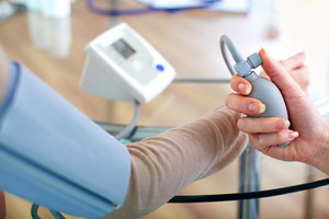 Close-up of doctor measuring pressure of patient on tonometer