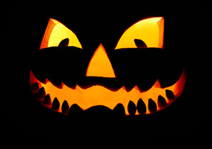 Close-up of grinning luminous pumpkin