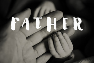 Close up of hands of young father and of his cute little newborn baby. Fathers day concept.