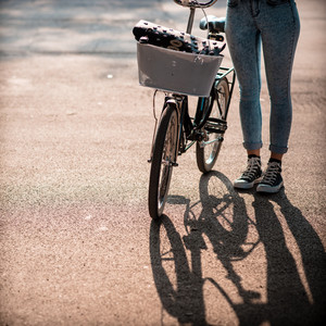 close up of legs woman on bike outdoor