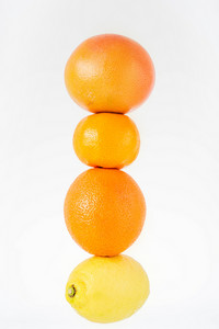 Close up of ripe fresh citrus fruits, tangerine fruit, orange, lemon, grapefruit isolated on white background