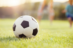 Close-up of soccer ball on grass lawn