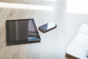 close up of tablet and smartphone on the floor at home