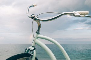 Close-up of the bike against the sea after the rain