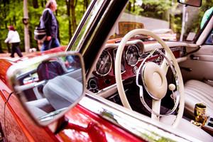 Close up of veteran car, dashboard, windshield, steering wheel, rearview mirror