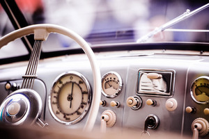 Close up of veteran car, dashboard, windshield, steering wheel, sunny summer day