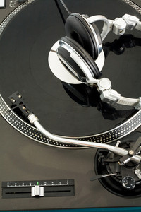 Close-up of vynil turntable with headphones on it