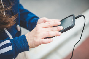 close up of woman hands using smart phone outdoor