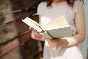 Close-up of woman reading book