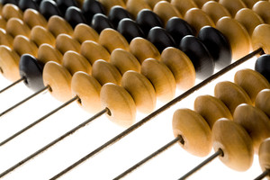 Close-up of wooden abacus used for counting
