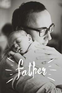 Close up of young father holding his newborn baby son in his arms. Fathers day concept.