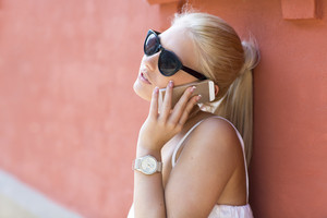 Close up of young girl talking in the phone