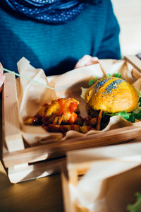 Close up on a veggie hamburger served in a basket with potato chips and ketchup - healthy, lifestyle, food concept