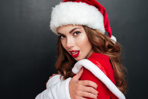 Close-up portrait of santa's helper over black background