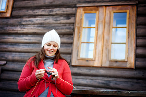 Close up portrait of winter girl knitting