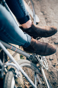 close up shoes of young beautiful hipster sporty blonde woman in town with bike