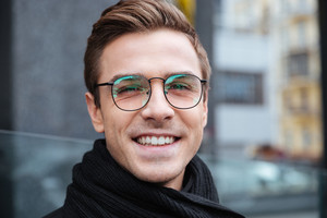 Close up smiling business man in glasses