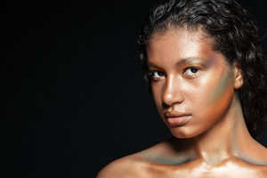 Closeup of beautiful african american young woman with stylish makeup over black background