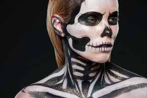 Closeup of girl with terrifying halloween makeup over black background
