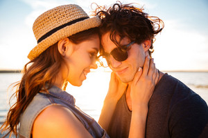 Closeup of happy beautiful stylish young couple on the beach