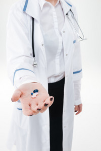 Closeup of woman doctor standing and giving young pills on hand over white background