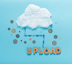 Cloud computing concept with upload cork letters