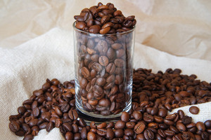 coffee beans in a transparent glass