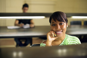 College library and female student, young african american woman studying at university