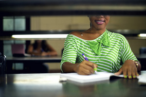 College library and female student, young african american woman studying with books at university