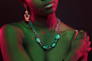 Colorful and creative portrait of african womans upper body with dark skin