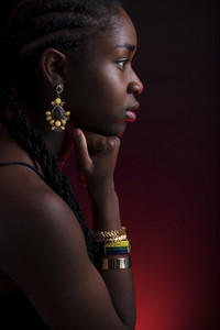 Colorful and creative side view portrait of african woman with dark skin