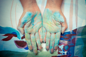 colorful painted hands on colored background