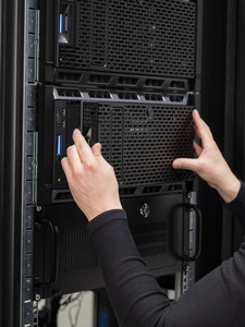 Colse-up of a IT consultant installing server in datacenter