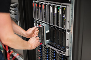 Computer Engineer Installing Blade Server In Data Center