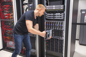Computer Engineer Installing Blade Server In Datacenter