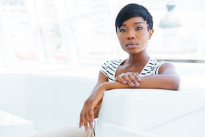 Concentrated african american young woman accountant sitting in office