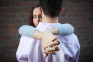 Conceptual image of female hands while embracing her sweetheart