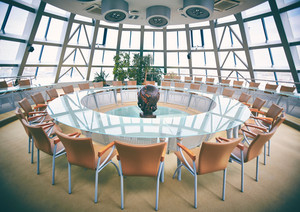 Conference hall with round table and chairs