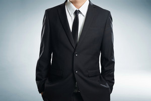 Confidence businessman in black suit , close up .